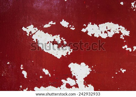 Red wall of peeling paint - stock photo