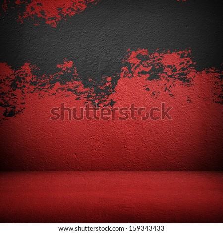 red wall with splash of paint  - stock photo