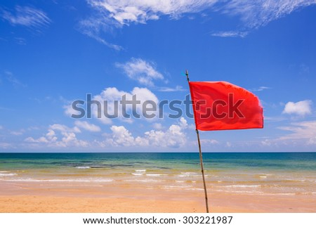 Red warning flag on beach, Thailand. - stock photo