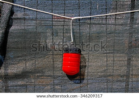 Red warning light on the fence - stock photo