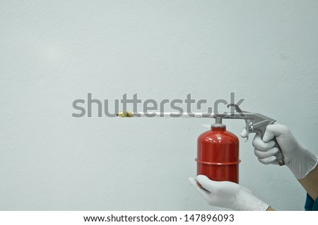 Red washing oil gun  - stock photo