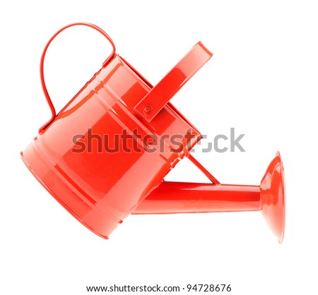 Red watering can. It is isolated on a white background - stock photo