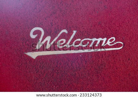 Red Welcome mat on the ground - stock photo