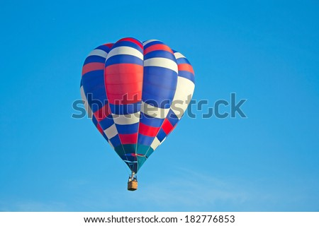 Red, white and blue hot air balloon.  - stock photo