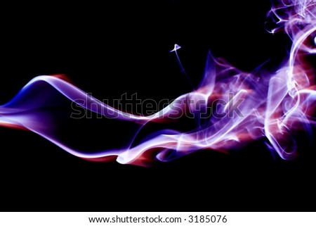 Red, white and blue smoke trails. - stock photo