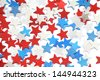 Red, white and blue stars on white background. - stock photo