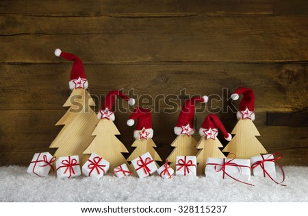 Red white christmas presents with handcrafted trees on old wooden background for decoration. - stock photo