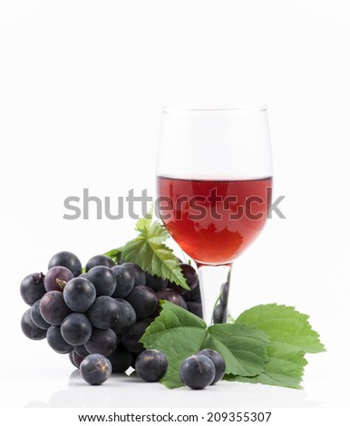 Red wine and grapes isolated on white - stock photo