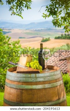 Red wine and grapes with pecorino cheese the Tuscan, Italy - stock photo
