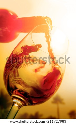 red wine and sunset - stock photo