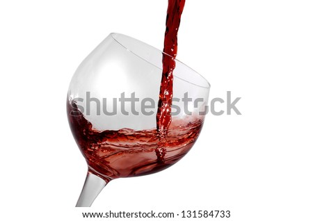 red wine being poured in a tilted wine glass isolation on white - stock photo
