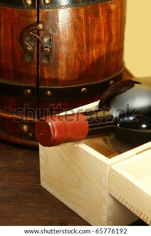 Red wine bottle in box - stock photo