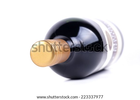 Red wine bottle isolated on the white background, very shallow focus - stock photo