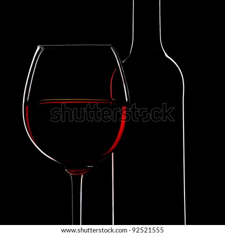 Red Wine Bottle silhouette and a Wine Glass on Black Background - stock photo