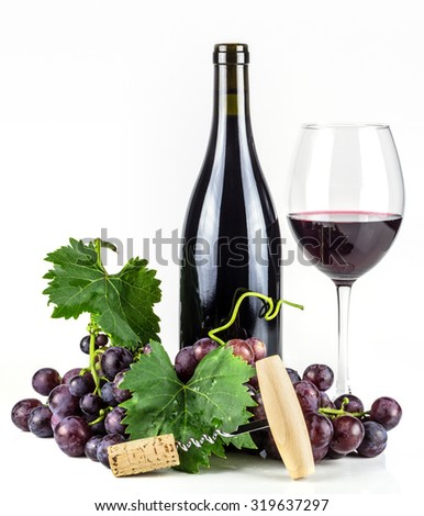 Red wine bottle, wineglass, grapes, and corkscrew. - stock photo