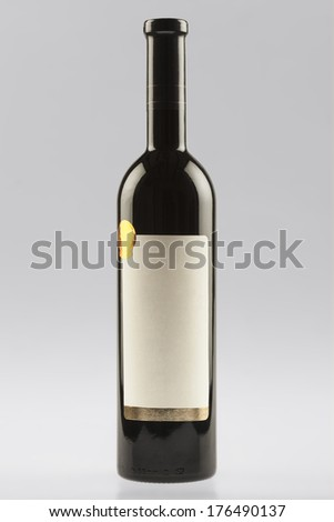 Red wine bottle with empty label - stock photo