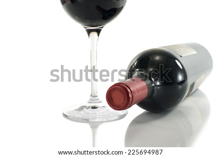 red wine bottle with glass isolated on white - stock photo