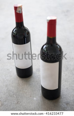 Red wine bottle, with real paper blank label - stock photo
