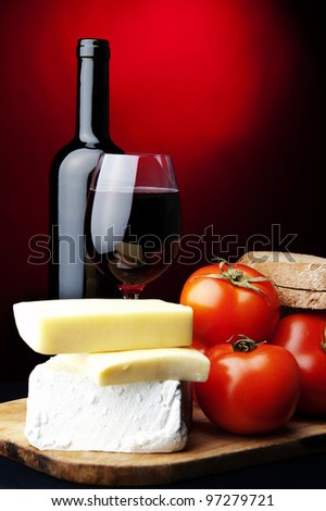 red wine,bread,tomato,cheese - stock photo