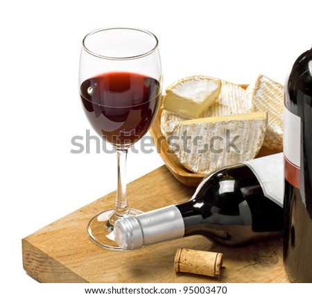 Red wine, Brie and Camembert  on the wood surface, studio shot, isolated, white background - stock photo