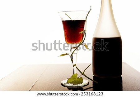red wine glass and bottle isolated on white - stock photo