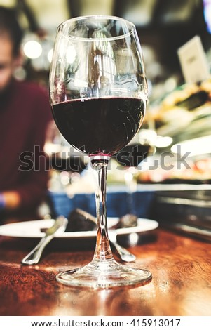 Red wine glass in a bar table. - stock photo