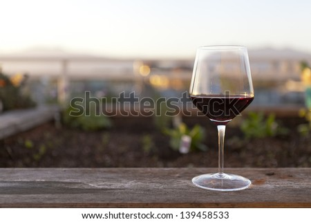 Red Wine glass on ledge - stock photo