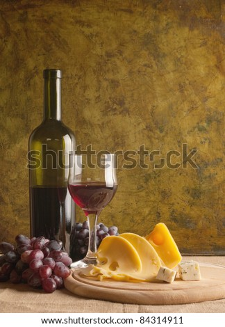 Red wine glass on vintage a background - stock photo