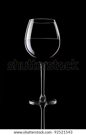 Red Wine Glass silhouette on Black Background - stock photo