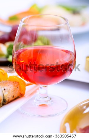 Red wine glass tableware - stock photo