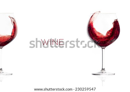 Red wine in a balloon glass. Splash. Wineglasses isolated on white background with sample text - stock photo