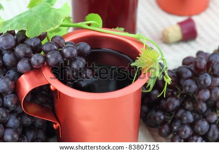 Red wine in a bronze pot - stock photo