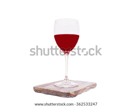 Red wine in a glass isolated,on the desk,  on white background - stock photo