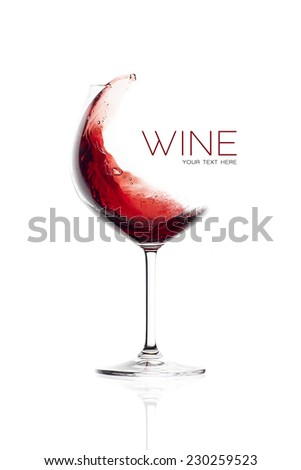 Red wine in balloon glass. Splash design. Wineglasses isolated on white background with sample text - stock photo