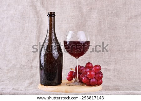 red wine in glass and bottle with grapes  - stock photo