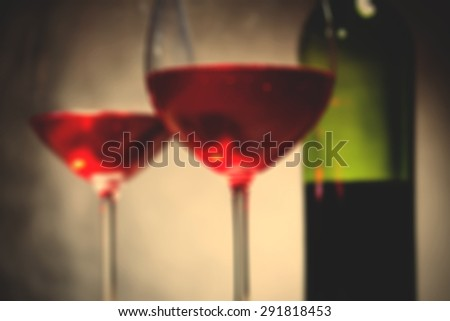 red wine in two goblets and bottle. romantic blur still life. instagram image filter retro style - stock photo
