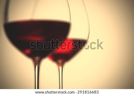 red wine in two goblets. romantic blur still life. instagram image filter retro style - stock photo
