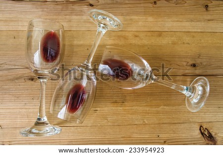 red wine on a wooden table  - stock photo