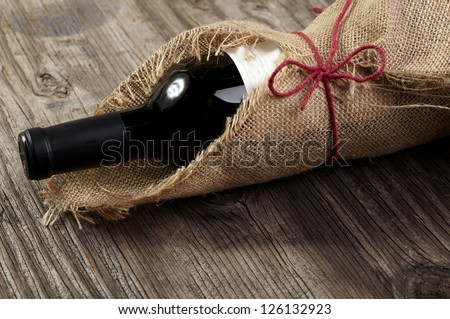 Red wine on wooden table - stock photo