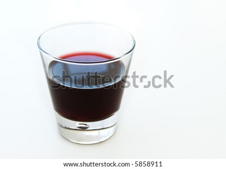 red wine or grape juice glass overlit on white background - stock photo