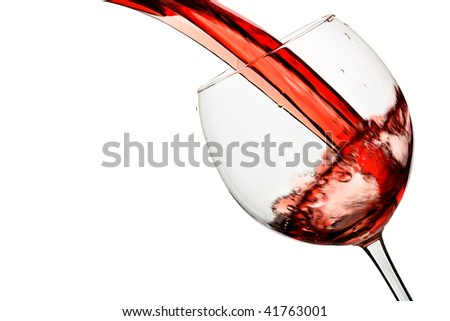 Red wine pour into glass isolated over white background - stock photo