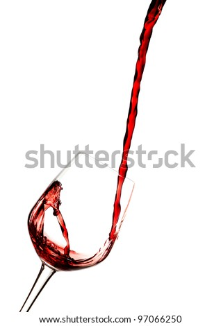 Red wine poured in a glass isolated on white. - stock photo