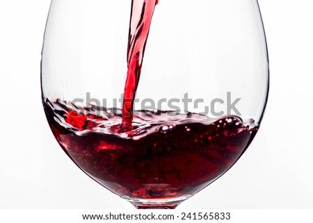 Red wine pouring - stock photo