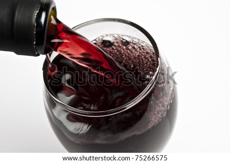 Red wine pouring close up - stock photo