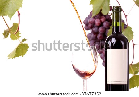 Red wine pouring down , grapes in background, isolated - stock photo
