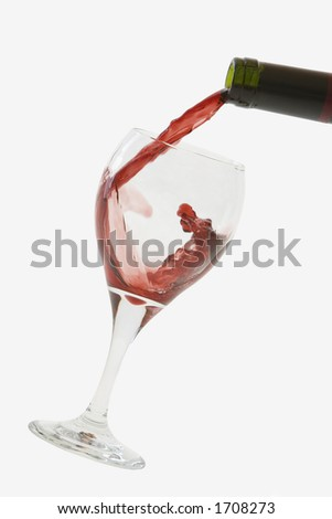 Red Wine pouring into glass - stock photo
