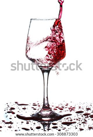 red wine pouring into wine glass isolated on white - stock photo