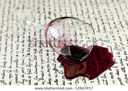 Red Wine Spilled On White Parchment Paper - stock photo