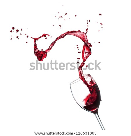 Red wine splashing from glass, isolated on white background - stock photo