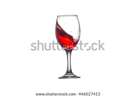 red wine splashing in wine glass on white background. - stock photo